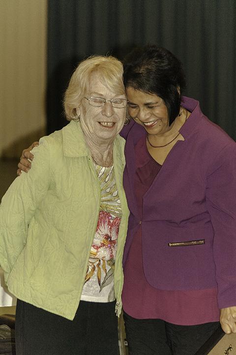 Perveen Khokhar hugs longtime volunteer Martha Beck during certificate award ceremony